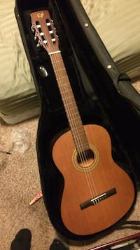 brown Epiphone classical guitar with black hard case Baytown, 77521