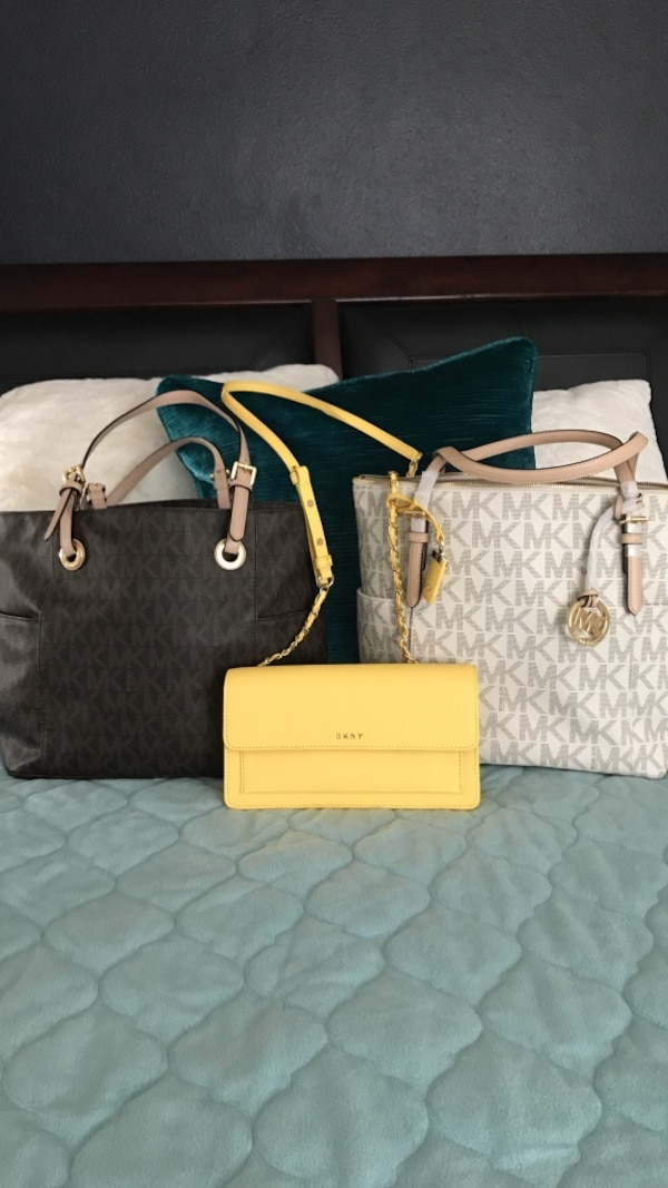 bf70cffca464 Used two black-and-brown and white-and-gray Michael Kors leather monogrammed  tote bags for sale in Oxnard