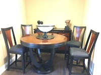 round brown wooden table with four chairs dining set Richmond Hill, L4C 1T5