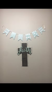 black and gray cross wall decor