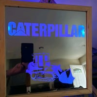 Caterpillar etched lighted mirror