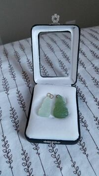 two green gem pendants with box