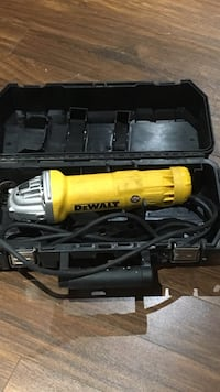 Yellow and gray dewalt angle grinder