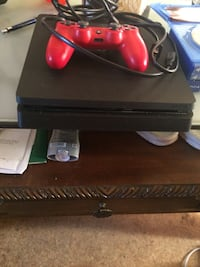 Black sony ps4 console with controller Cheney