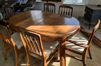 Solid oak table and six chairs. 42x 60  Frederick, 21703