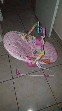 baby's pink and white floral bouncer Hialeah, 33014