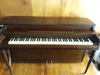 brown wooden framed upright piano Baltimore, 21207