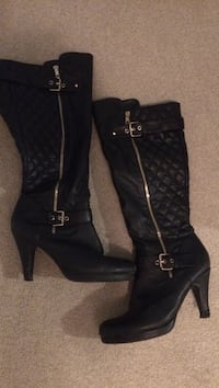 pair of black leather heeled boots Calgary