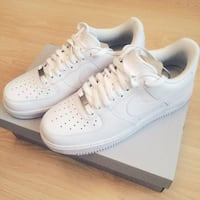 pair of white Nike Air Force 1 low
