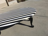 Striped white and black oval wood coffee table with drop down sides Price, 84501