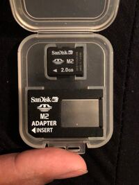 black 2 GB SanDisk Micro SD card with adapter