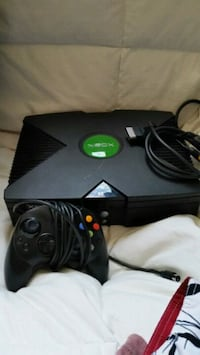 black Xbox Original console with controllers.