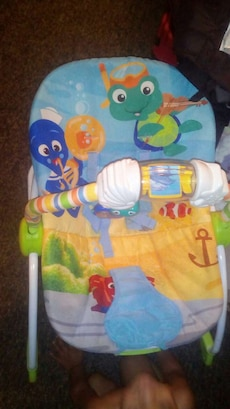baby's blue, yellow and green underwater theme bouncer seat