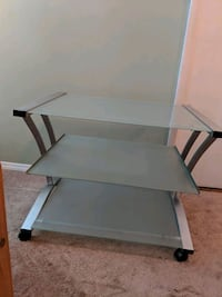 gray metal framed glass top TV stand Cleveland, 37323