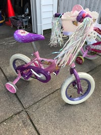 Toddler's pink and purple bicycle with training wheels princess