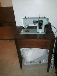 gray electric sewing machine with wooden table Bridgeport, 06608