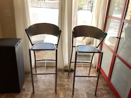 Price is firm - 2 Steel and (blue stained) wood bar stools