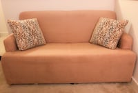 Sofa bed w/ cover and throw pillows