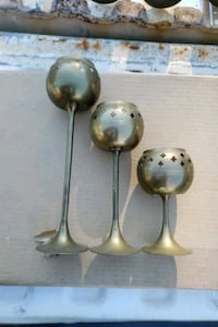 3 brass candle holders  Thomasville, 27360
