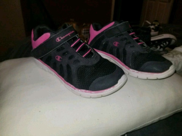 pair of black-and-pink running shoes
