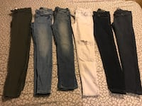 Four pairs of blue and black jeans