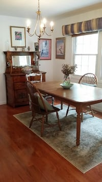 Amish solid oak dining room table and 2 matching c Crofton, 21114