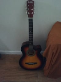 brown and black dreadnought acoustic guitar Hyattsville, 20781