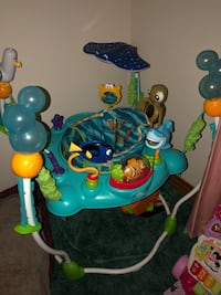 baby's blue and green jumperoo 1489 mi