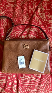 3d1d067efcdc Used Brown leather Michael Kors crossbody purse for sale in ...