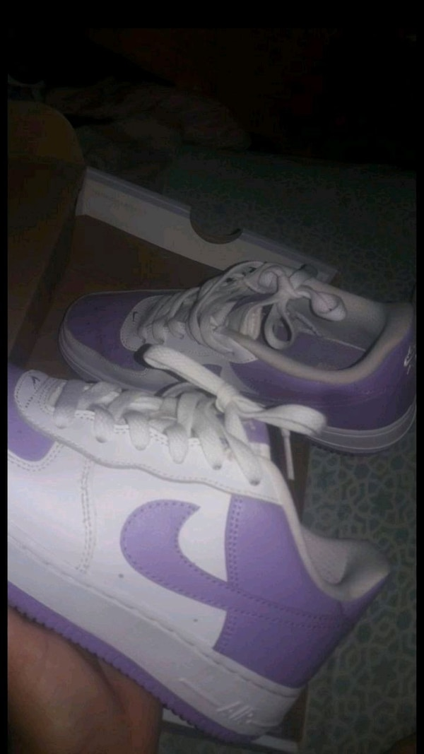 pair of purple Nike low-top sneakers screenshot