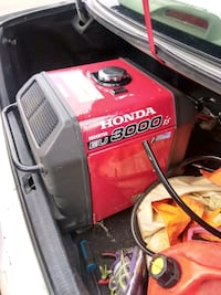 red and black Lincoln Electric welding machine Vancouver, V6A