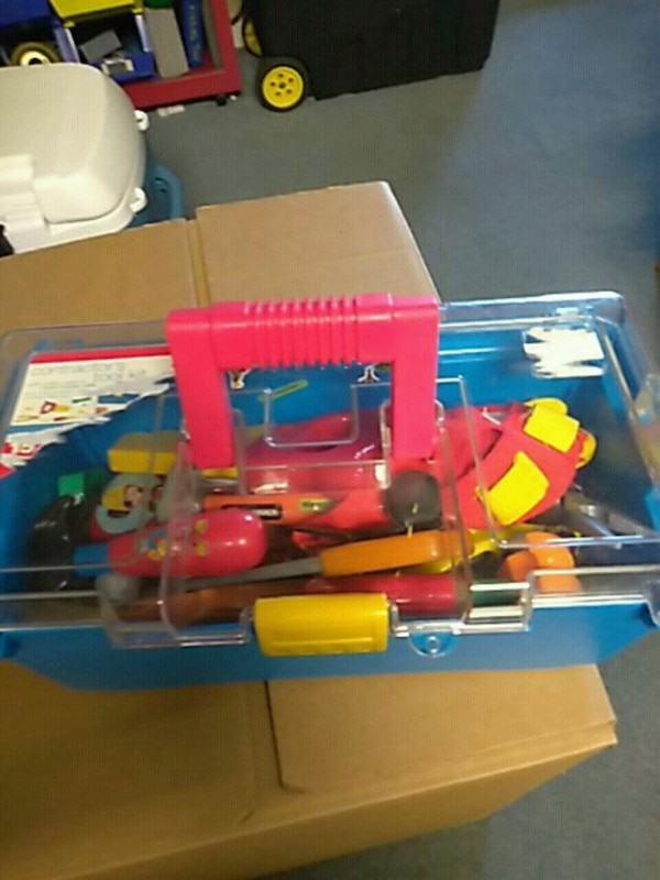 red and blue plastic tools fir kids