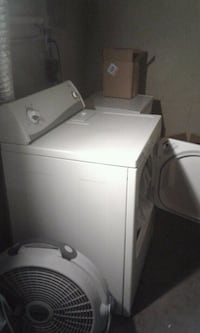 white top-load clothes washer and dryer set