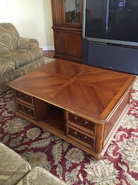 gray rear projection television; brown wooden coffee table