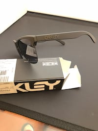 black and gray framed Oakley sunglasses with box Anaheim, 92805