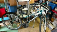 black and green Equator hybrid mountain bicycle Essex, 21221