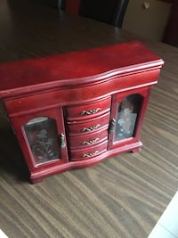 red wooden display cabinet