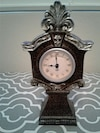 brown wooden table clock