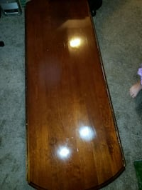 brown wood coffee table. Has 2 matching end tables 25 mi