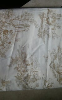 white and brown floral textile 362 mi