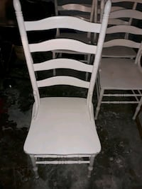 4 farmhouse white wooden chairs for sale.