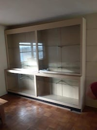 white wooden framed glass display cabinet