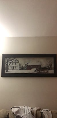 Black wooden framed painting of house