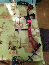 PSE Supra Compound Bow with target and arrows.  Delta, V4G 1C9