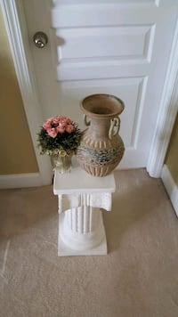 1. White column 2. Ceramic 2 handle case. 3. Dried roses in small vase Indian Trail