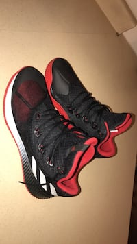Pair of black-and-red mid-top Adidas  sneakers Sioux Falls, 57103
