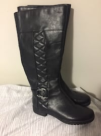 Pair of black leather knee-high boots Edmonton, T5C 2A7
