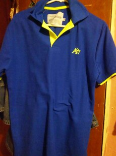 blue and yellow polo shirt