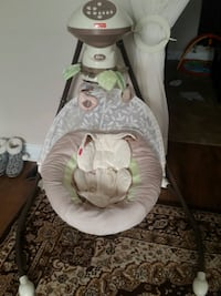 baby's white and green cradle and swing 723 km
