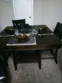 rectangular black wooden table with four chairs dining set Houston, 77060